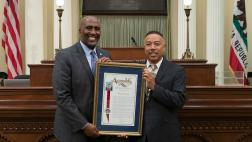 Assemblymember Cooper presenting Assembly Resolution to Mike Bradley