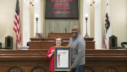 Assemblymember Cooper presents Assembly Resolution to Cordelia Valdez on her retirement.