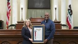 Assemblymember Cooper presents Jennifer Freeworth an Assembly Resoution on her retirement.