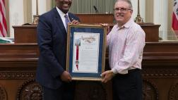 Assemblymember Cooper presenting Assembly Resolution to Mitchell E. Slate