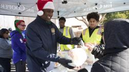Assemblymember Cooper and volunteers at turkey distribution tables