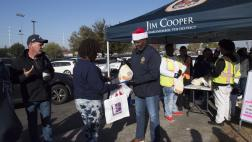 Assemblymember Cooper handing out turkey to constituents